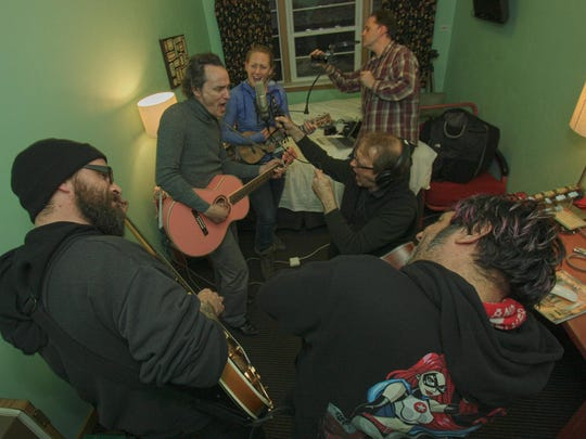 """Clockwise from left, Greg Roitek, James Hall, Victoria Vox, Robin Bienemann, James Larson and Vee Sonnets work on a brand new """"Love on Holiday"""" song in the Holiday Music Motel during last year's songwriting event."""
