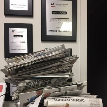 A typical scene in the News Journal office.