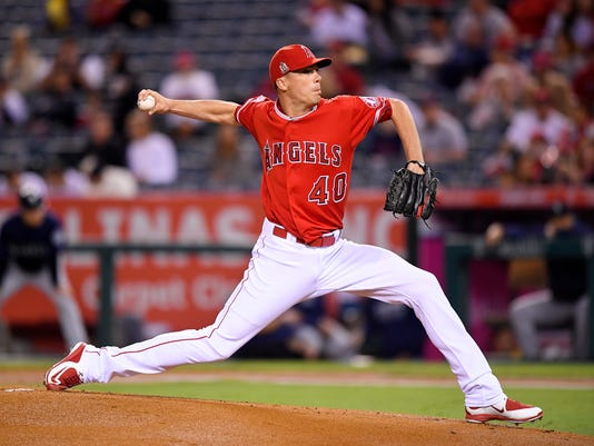 Los Angeles Angels starting pitcher Alex Meyer throws to the plate during the first inning of a baseball game against the Seattle Mariners, Tuesday, Sept. 13, 2016, in Anaheim, Calif. (AP Photo/Mark J. Terrill)