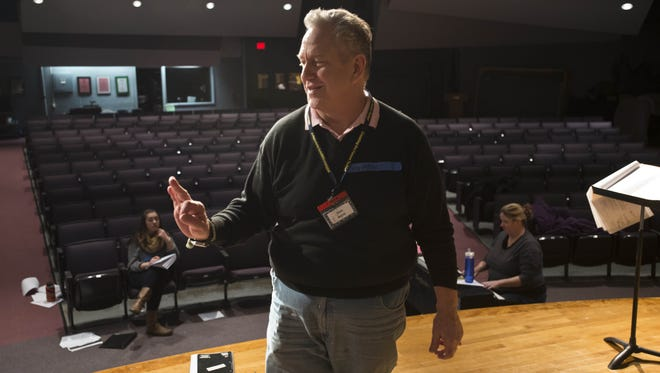 "Sean Moran is shown in 2015 directing the Williston Central School production of ""Grease"", the very movie musical he performed in."