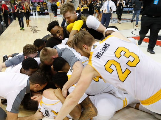 NKU players celebrate their victory in the Horizon League championship game.