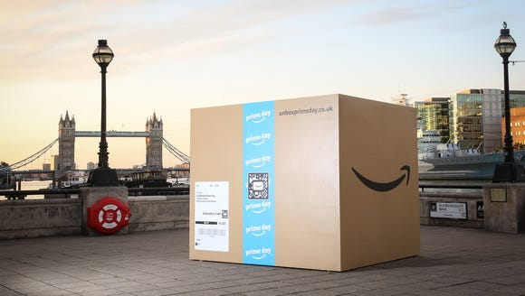 A 25-foot Amazon box sits near the Thames river in