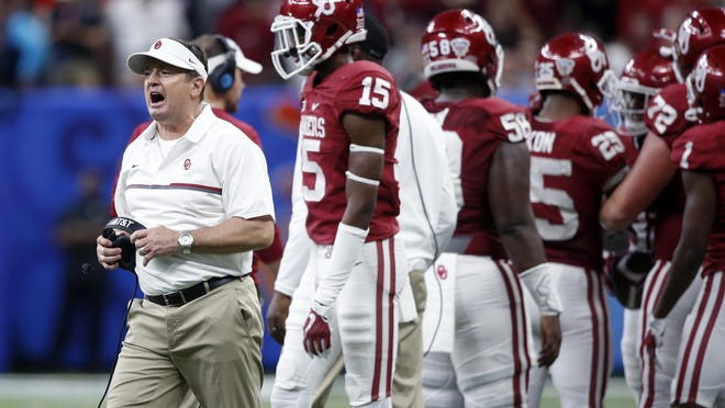 Oklahoma head coach Bob Stoops calls out from the sideline in the second half of the Sugar Bowl NCAA college football game against Auburn in New Orleans, Monday, Jan. 2, 2017. Oklahoma won 35-19.