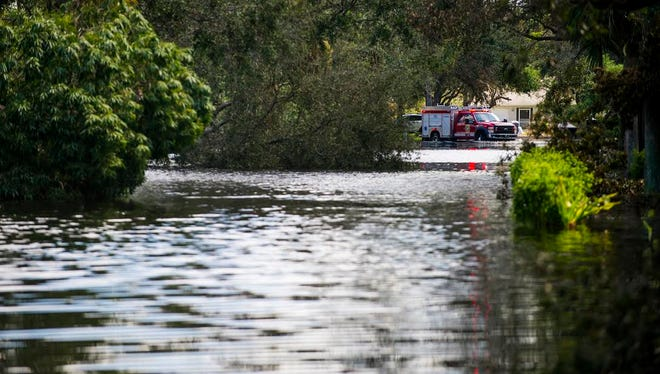 A fire engine turns down Londonderry Lane during flooding in Morton Grove from Hurricane Irma on Saturday, Sept. 16, 2017.