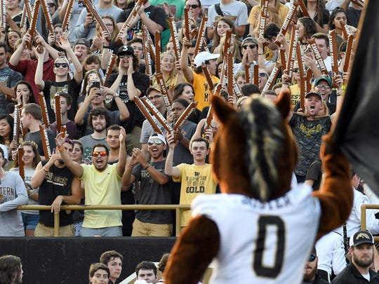 The WMU student section reacts to Buster's new look.