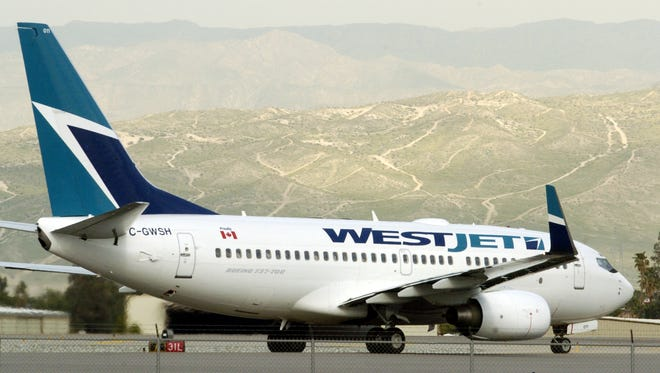 A WestJet airplane prepares to takeoff out of Palm Springs International Airport. The airline confirmed on Thursday that it has discontinued its nonstop service between Palm Springs and Toronto based on dwindling demand.