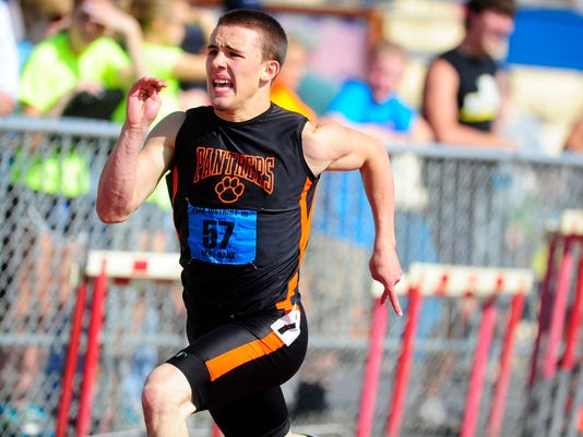 Central York's Jay Stone sprints before the last hurdle during the 300-meter race Saturday during Day 2 of the District 3 Track and Field Championships. ( DAILY RECORD/SUNDAY NEWS -- CHRIS DUNN)
