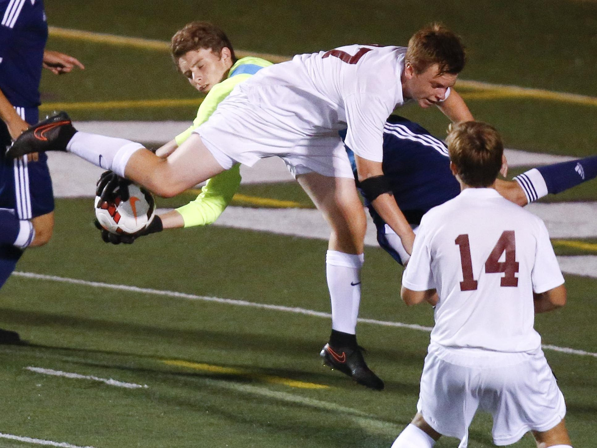 Caravel's Lucas Partlow collides with Salesianum goalkeeper Gavin Campbell in the first half of Salesianum's 3-0 win at Caravel Tuesday.