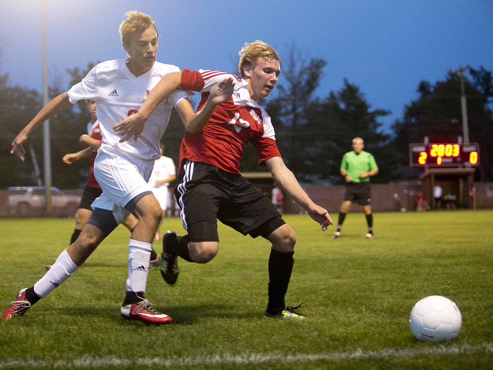 Stevens Point Area Senior High School's Jordan Schrieber, left, goes against Wisconsin Rapids' Colin Lindvig during Wisconsin Valley Conference soccer game Tuesday at Washington Field in Wisconsin Rapids.