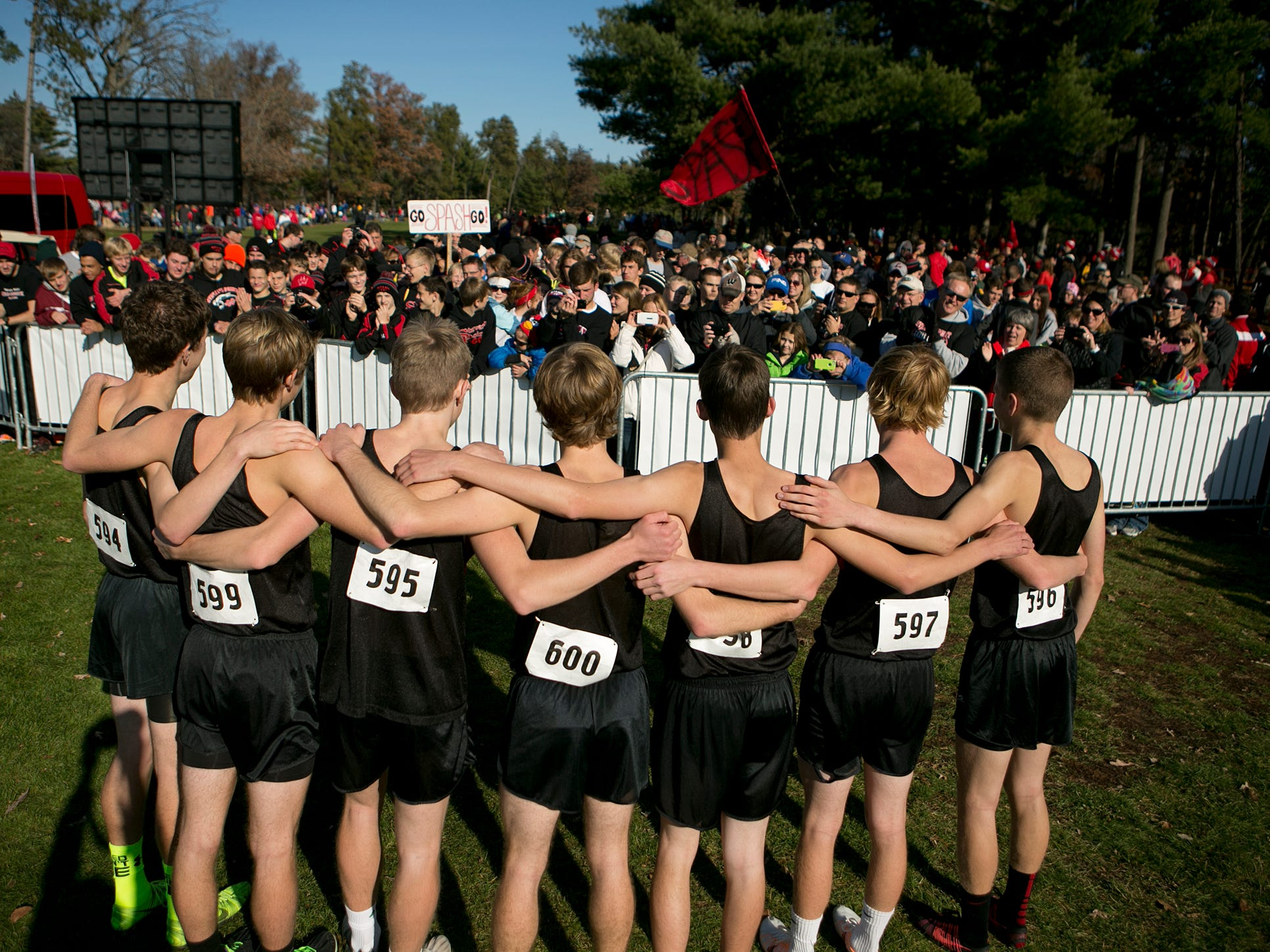 The Stevens Point Area High School boys cross country team poses for photos after coming in second during the Division 1 race during 2014 State Cross Country Championships at the Ridges Country Club in Wisconsin Rapids, Saturday, Nov. 1, 2014.