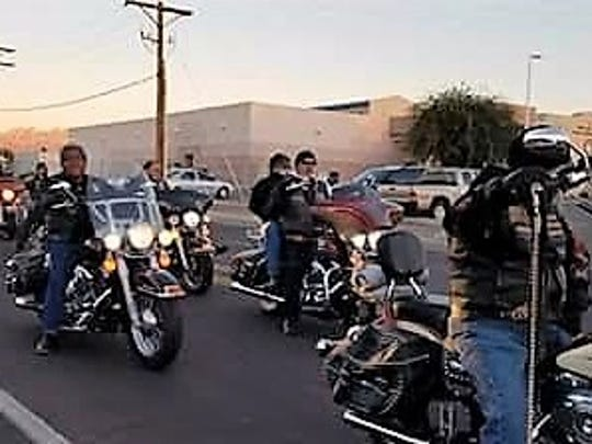 Members from BMC, Soldados, Stryx, Squad, Embudos, Rifa, combat Vets, Guardians of Children and independent bikers helped out during a food drive event Wednesday, Nov. 22, 2017.