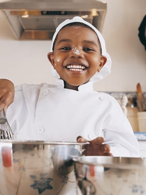 For younger children, start with simple steps – let them put toppings on a pizza or decorate cupcakes.