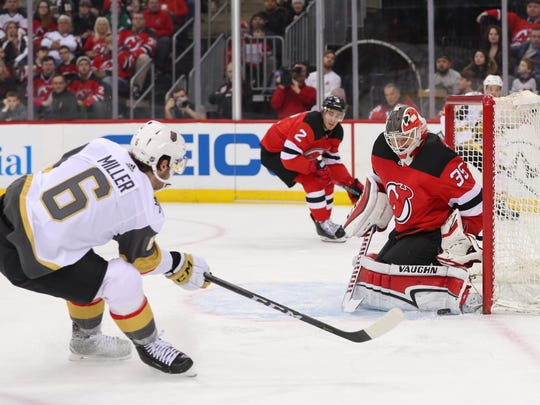 New Jersey Devils goaltender Cory Schneider (35) makes a save on Vegas Golden Knights defenseman Colin Miller (6) during the first period at Prudential Center.