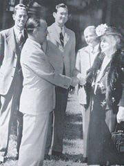 Mina Edison is pictured with Mayor Shapard and to her right, Sidney Davis. 1947.