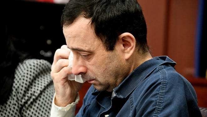"""Victim Jennifer Bedford makes her """"mpact statement to Larry Nassar during a sentencing hearing that brings him to tears in front of Judge Rosemarie Aquilina in district court Tuesday in Lansing, Mich."""