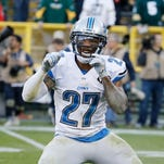 Detroit Lions safety Glover Quin reacts after an 18-16 win against the Green Bay Packers on Sunday, Nov. 15, 2015, in Green Bay, Wis.