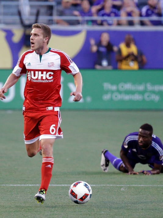 New England Revolution's Scott Caldwell (6) reacts to a call by an official after knocking down Orlando City 's Kevin Molino, right, during the first half of an MLS soccer game, Sunday, July 31, 2016, in Orlando, Fla. (AP Photo/John Raoux)