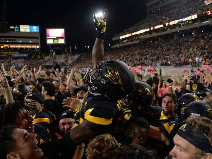 Arizona State Sun Devils players celebrate after the