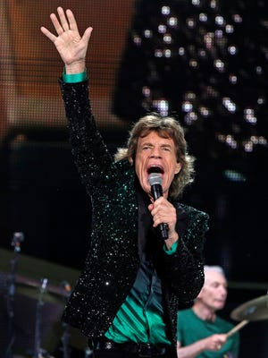 Mick Jagger gestures as The Rolling Stones play at the Marcus Amphitheater in Milwaukee, Wisc., Tuesday, June 23, 2015.