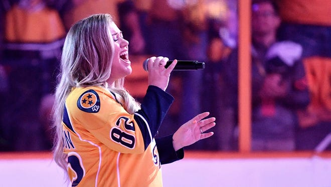 Kelly Clarkson sings the national anthem before game four of the Western Conference finals at Bridgestone Arena Thursday, May 18, 2017 in Nashville, Tenn.