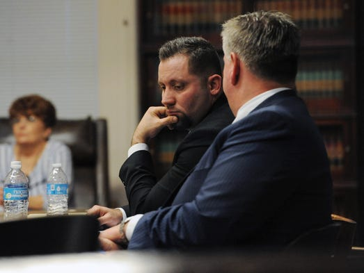Joel Jenkins, left, listens to his attorney, Mark Collins,