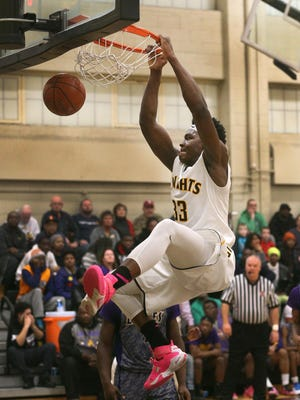 McQuaid's Isaiah Stewart finds himself alone under the basket and goes up for the dunk against East.