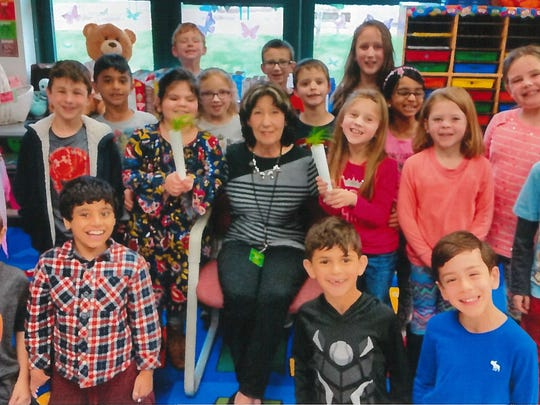 Raegan Haluszka and Jacqueline D'Ruso (center)celebrated Arbor Day with their first-grade classmates at Whiton School in Branchburg with a presentation with local tree expert Dr. Barbara Ronca, a psychotherapist.