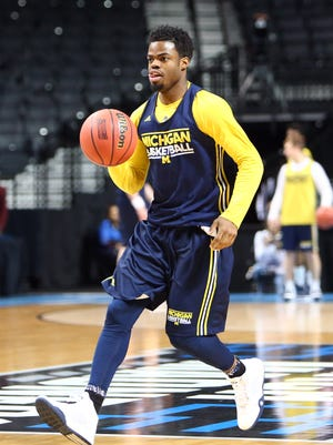 Mar 17, 2016; Brooklyn, NY, USA;  Michigan Wolverines guard Derrick Walton Jr. during a practice day before the first round of the NCAA men's college basketball tournament at Barclays Center.