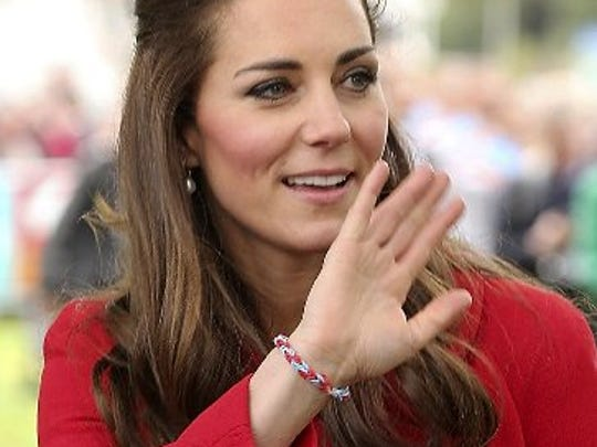 Britain's Duchess of Cambridge waves during a visit to New Zealand in April 2014, while wearing a loom band.