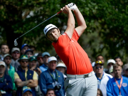 Jon Rahm, of Spain, hits on the fourth hole during the fourth round at the Masters golf tournament Sunday, April 8, 2018, in Augusta, Ga. (AP Photo/Chris Carlson)