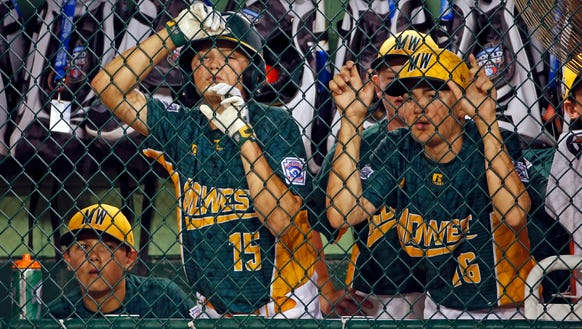Sioux Falls, S.D. players watch from their dugout during