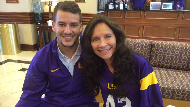 Louisiana State University kicker Colby Delahoussaye and Karen Sadler, the mother of the late former Michigan State University punter Mike Sadler, have become good friends since the car accident that claimed the lives of Sadler and Nebraska punter Sam Foltz in late July. Delahoussaye escaped the back seat of that car with burns on his legs.