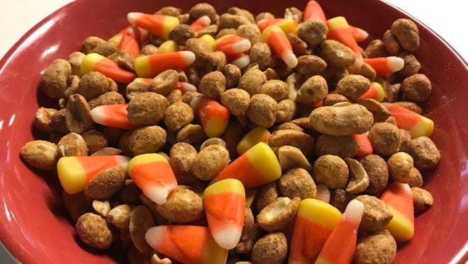 Candy corn mixed with salted, dry-roasted peanuts tastes like an actual Payday bar. No, really.