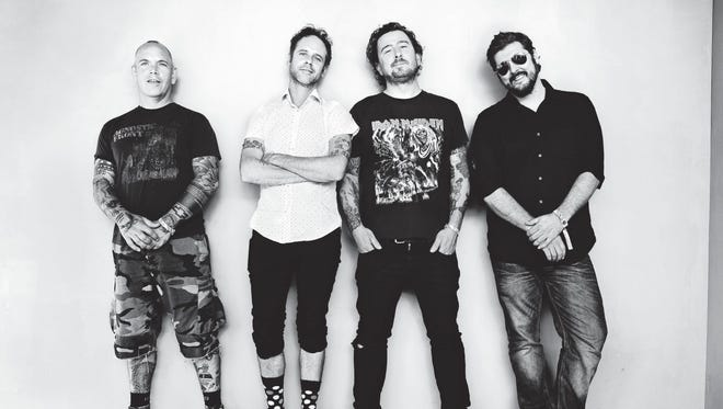 The Bouncing Souls are Bryan Kienlen (left to right), Greg Attonito, Pete Steinkopf and George Rebelo.