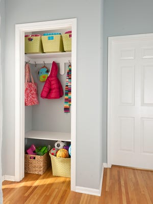 "In this photo provided by Better Homes & Gardens, a small closet usually says ""no storage,"" but if you show it as a children's closet, you've created instant charm with a clever solution. Add a low shelf or two and stage it accordingly."