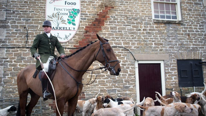 Hounds and riders with England's Beaufort Hunt gather at the Volunteer Inn in Great Somerford, Wiltshire, for a Boxing Day fox hunt. More than 250,000 people are expected to be supporting close to 300 registered hunts this year, the busiest hunting day of the year.