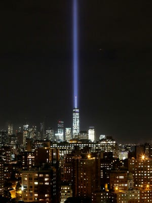 The Tribute in Light illuminates the sky behind One World Trade Center and the lower Manhattan skyline, Wednesday, Sept. 9, 2015 in New York. Friday marks the fourteenth anniversary of the terrorist attacks of Sept. 11 on the United States. (AP Photo/Mark Lennihan)