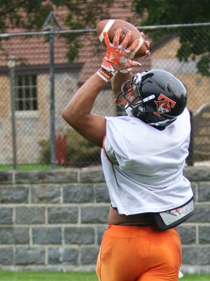 Senior Brevyn Spann-Ford hauls in a long touchdown pass during practice Monday, Aug. 21, at Tech High School.
