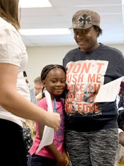 Tu'Nijah Miller, 6, says goodbye to her mother, Anitta