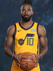 Utah Jazz guard Mike Conley (10) poses for a photograph during the NBA basketball team's media day Monday, Sept. 30, 2019, in Salt Lake City. Utah changed the entire dynamic of its backcourt after acquiring veteran point guard Conley from the Memphis Grizzlies in July. (AP Photo/Rick Bowmer)