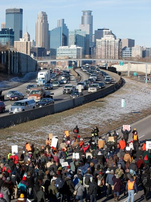 Protesters march toward downtown Minneapolis on Interstate 35W shutting down the freeway in 2014, a day after a grand jury decided not to indict a New York City police officer in the death of Eric Garner.