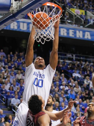 Kentucky's Marcus Lee slams down two points over South Carolina's Michael Carrera during 77-43 blasting of the Gamecocks Saturday afternoon in Rupp Arena. By Matt Stone, The Courier-Journal February 14, 2015
