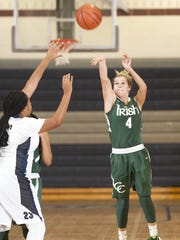 Camden Catholic's Julia Braungart, right, recently surpassed the 1,000-point mark for her career.