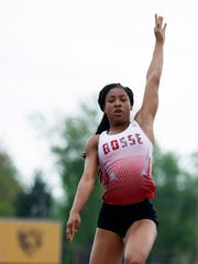 Tionne Brigham wins the SIAC long jump with a leap of 17-1. She improved her distance dramatically at sectional.