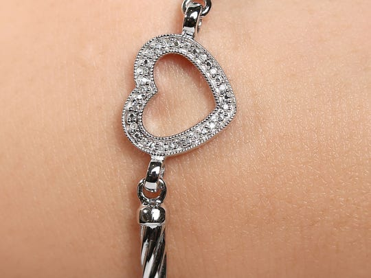 This sterling silver, diamond heart bracelet for $75 will bring a smile to your special lady.