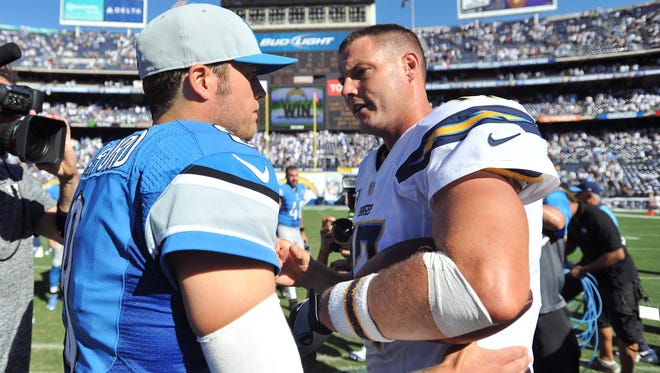 Detroit Lions quarterback Matthew Stafford, left, and San Diego Chargers quarterback Philip Rivers meet after the game at Qualcomm Stadium.
