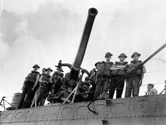 USS Ward's gun crew pose at their weapon after the