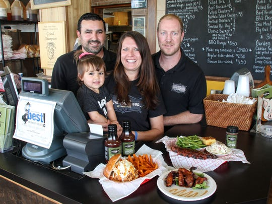 Local Smoke BBQ owners Steve Raab (from left), Loren Raab, and Eric Keating, and Emma Raab, in their Neptune City restaurant. Local Smoke BBQ will open at Jaz Garage in Seaside Heights this spring.