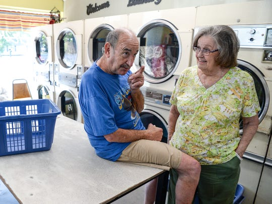 Charles Royster, left, of Sandy Springs tells a story