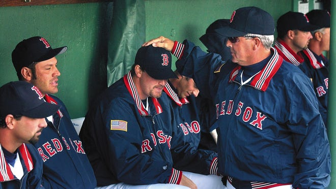 Then-Red Sox manager Grady Little greets his players before the team's season opener in 2002. Since then Boston has seen Little, and five other managers come and go, with a new one to be named before the start of next season.